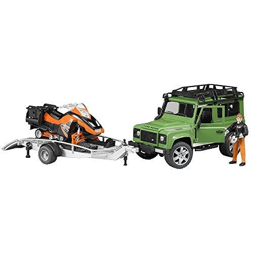 Bruder 02594 - Land Rover Defender Station Wagon mit Anhänger, Snowmobil, Fahrer und Zubehör